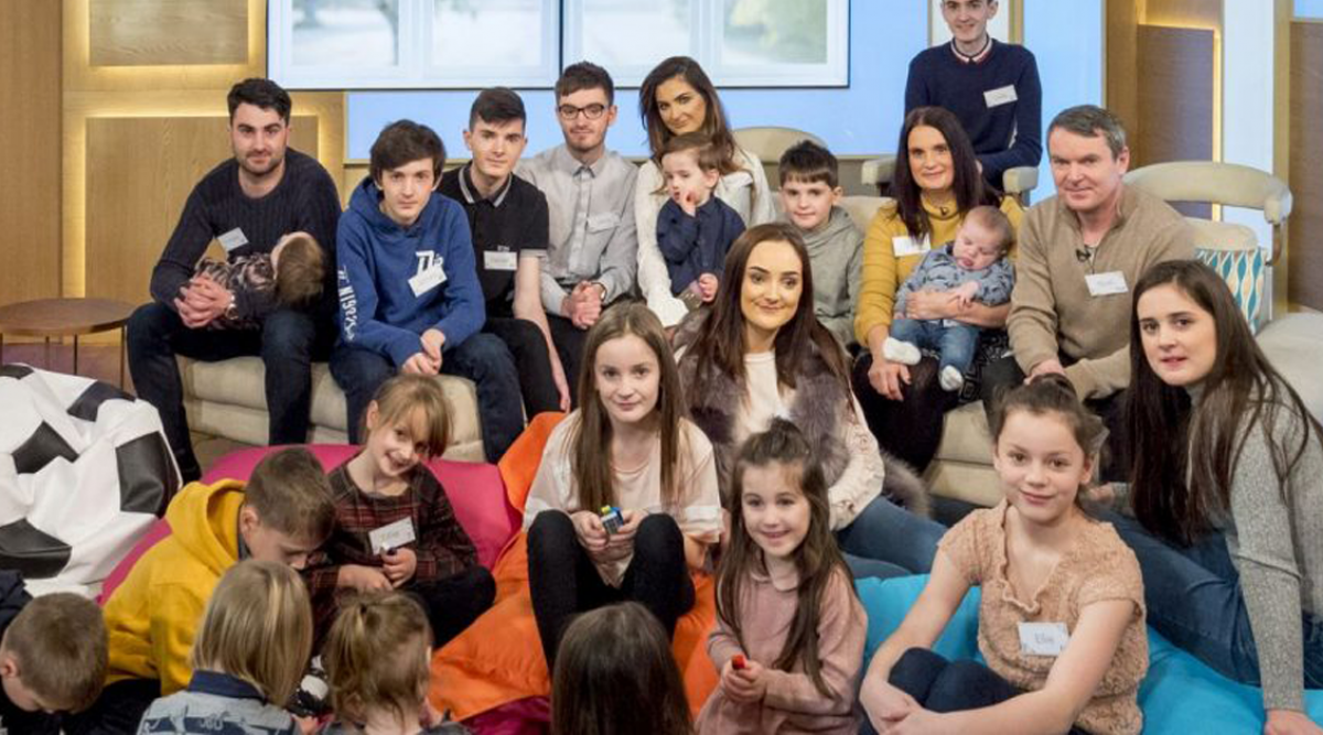 Cette famille souhaite la bienvenue à leur 21ème bébé et promet que c'est le dernier