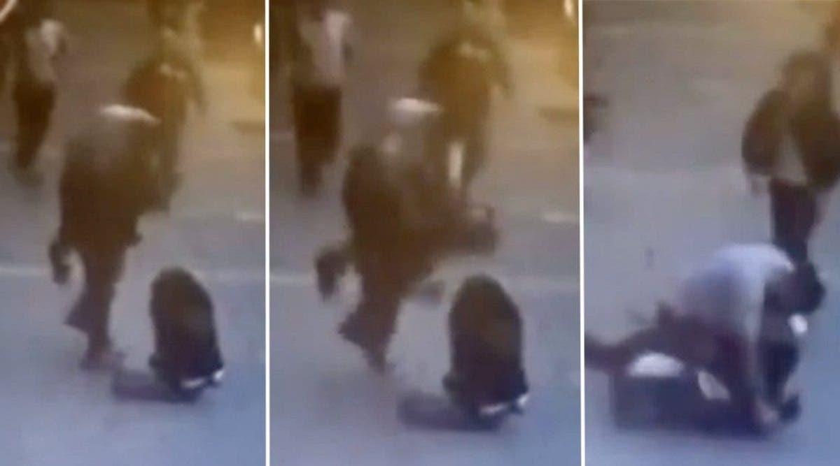 Une femme battu en public se fait venger par un étranger