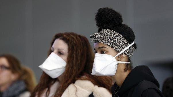 Nous pourrions avoir besoin de porter des masques pendant au moins un an