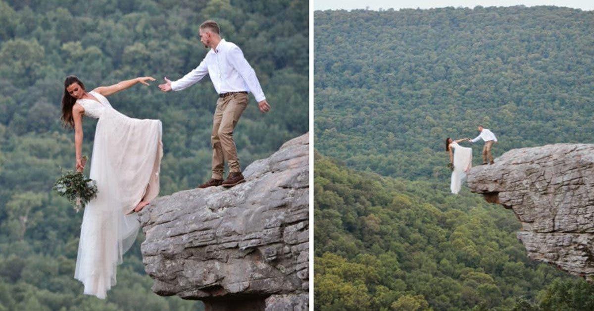des-jeunes-maries-pose-au-bord-dune-falaise-pour-une-seance-photo-de-mariage-extreme