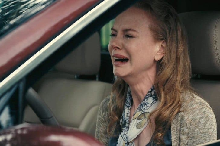 femme pleure volant voiture