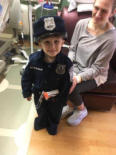nolan costume policier